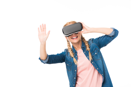 happy blonde girl using virtual reality headset isolated on white  Stock Photo
