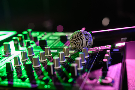 close up view of sound mixer with microphone in nightclub