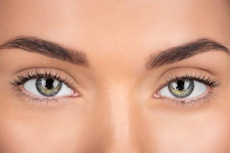 close-up shot of woman with beautiful eyes looking at camera