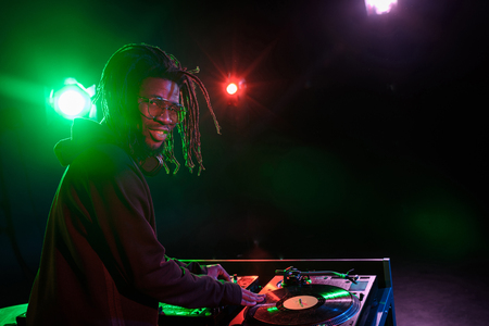 professional african american club DJ with sound mixer in nightclub Stock Photo - 102661747