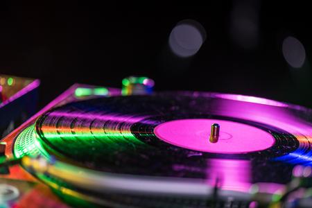 selective focus of sound mixer with vinyl in nightclub Stock Photo
