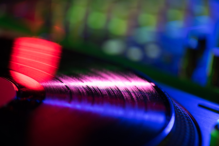 close up view of vinyl in nightclub with dramatic lighting Stock Photo
