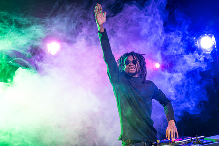 professional african american club DJ with sound mixer in nightclub Stock Photo - 102662051