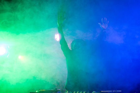 professional african american DJ in nightclub with back light Stock Photo