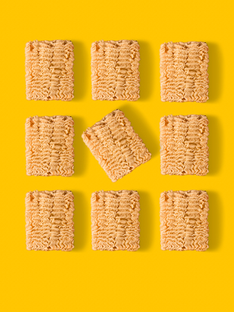 top view of instant noodles composition on yellow Stock Photo