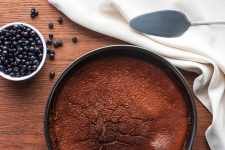 top view of delicious homemade brownie and fresh blueberries on wooden table Stock Photo