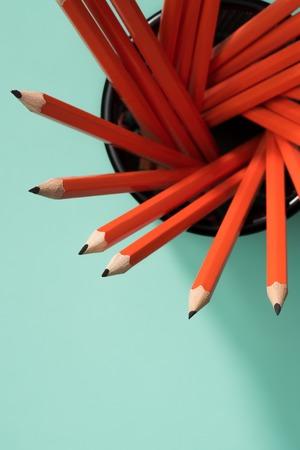 top view of graphite pencils in desk organizer on green