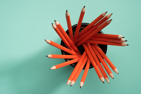 elevated view of graphite pencils in desk organizer on green Stock Photo