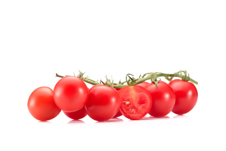 close up view of ripe cherry tomatoes on twig isolated on white Stock Photo