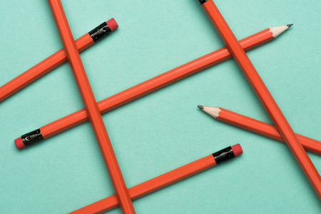 top view of arranged graphite pencils with erasers on green Stock Photo - 104570790