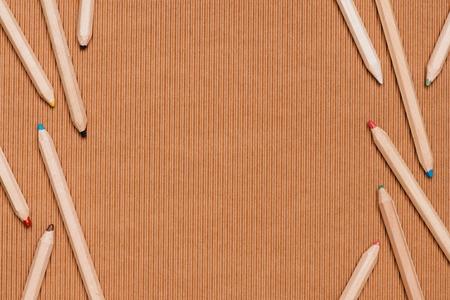 top view of arranged colorful pencils on beige Reklamní fotografie