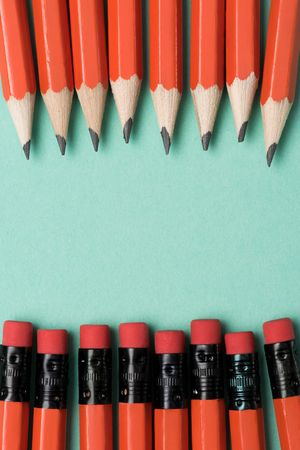 top view of graphite pencils and erasers on pencils placed in rows on green Stock Photo - 104570967