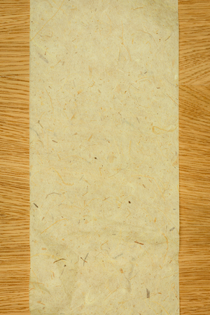 elevated view of blank chipboard on wooden table Stock Photo