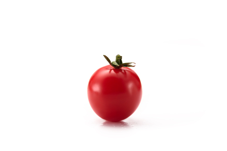 close up view of ripe cherry tomato isolated on white