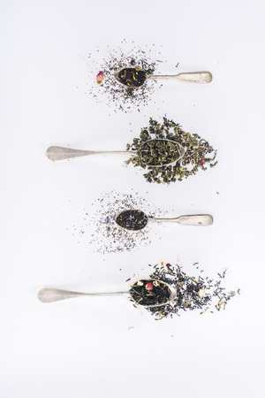 top view of healthy aromatic herbal tea and spoons on grey 写真素材