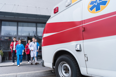 paramedic team going from hospital to ambulance Stok Fotoğraf