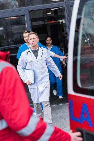 serious doctors going from hospital to ambulance Stock Photo
