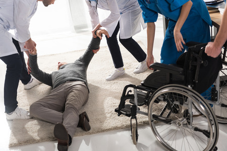 cropped image of doctors helping unconscious man in a hospital Stock Photo