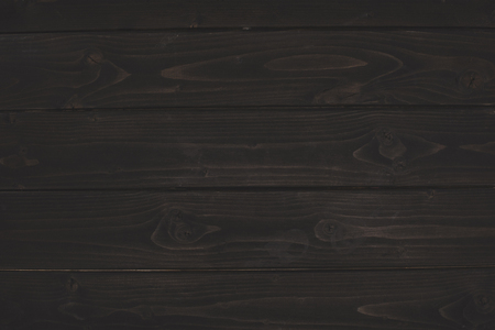 dark wooden background with copy space Фото со стока