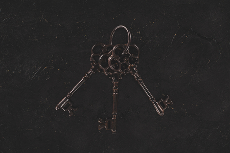 top view of vintage metal bunch of keys isolated on black