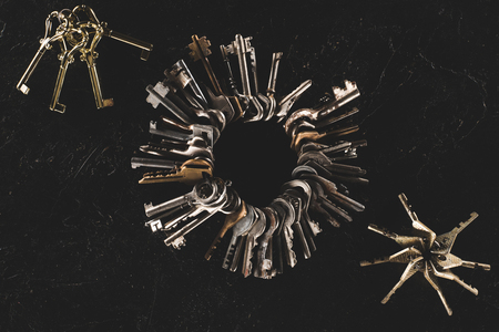top view bunches of different keys isolated on black