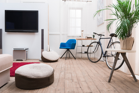 Interior of living room with TV and bicycle 写真素材