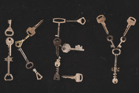 top view of metal keys forming word isolated on black Stok Fotoğraf