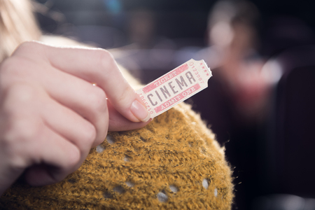 cropped view of woman holding cinema ticket Banco de Imagens