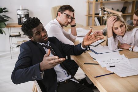 overworked buisness partners having conversation at office Standard-Bild - 104662607