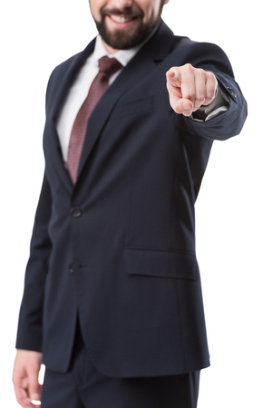 cropped view of businessman in suit pointing at you, isolated on white