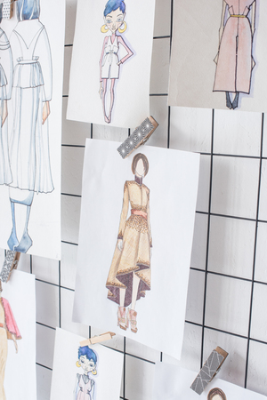 sketches of fashion outfit hanged on white checkered background 写真素材