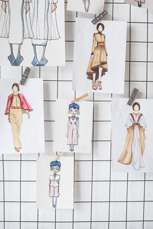 sketches of fashion outfit hanged on white checkered background Stok Fotoğraf
