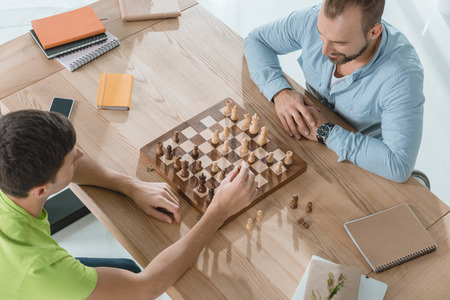 high angle view of young men playing chess Stok Fotoğraf - 104664722