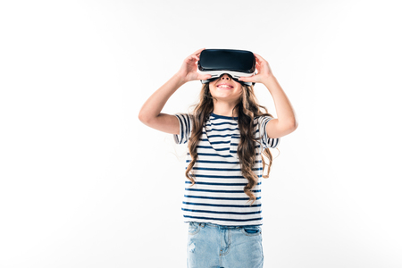 Preschooler kid watching something with VR headset isolated on white