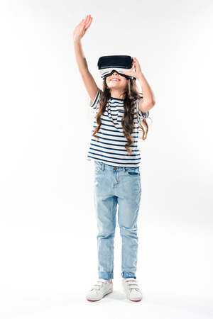 child watching something in virtual reality headset and touching with hand isolated on white
