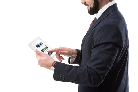 Cropped view of businessman in suit using digital tablet with youtube website, isolated on white Editorial