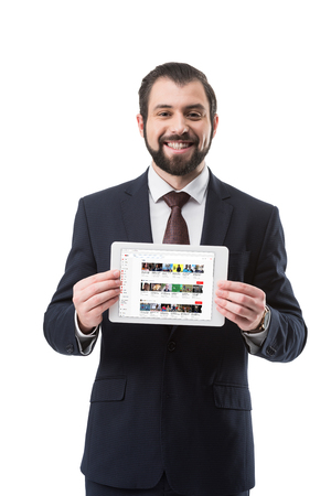 smiling businessman showing digital tablet with youtube website, isolated on white Editorial