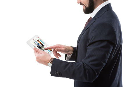 Cropped view of businessman in suit using digital tablet with pinterest website, isolated on white