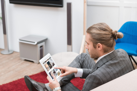 businessman using digital tablet with pinterest website at home Editorial