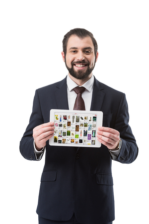 Smiling businessman showing digital tablet with pinterest website, isolated on white Editorial