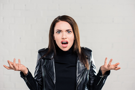 Portrait of screaming woman looking at camera
