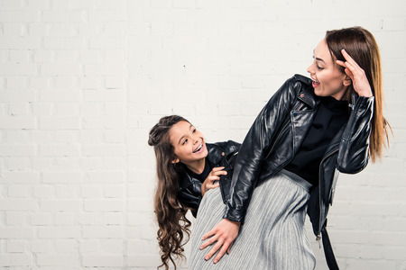 Stylish mother and daughter having fun Stock Photo