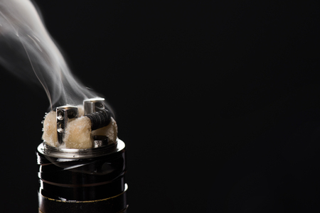 Activating electronic cigarette isolated on black background