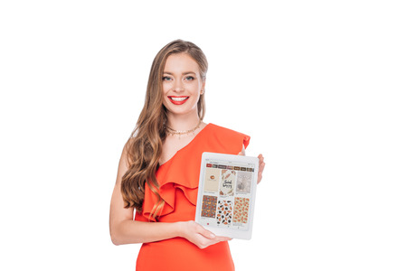 elegant smiling young woman holding digital tablet with pinterest website on screen isolated on white Editorial