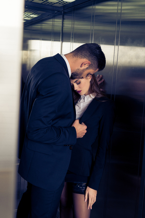 sensual attractive business couple in elevator