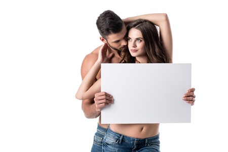 young sensual couple in jeans with blank board isolated on white Stock Photo