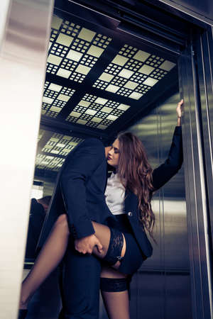 sensual young business couple in elevator