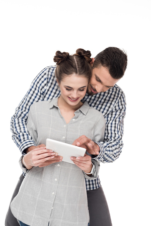 happy couple using tablet isolated on white