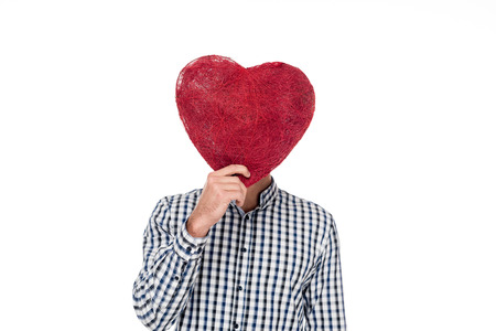 man covering face with heart of threads isolated on white, valentines day concept Banco de Imagens - 104832145