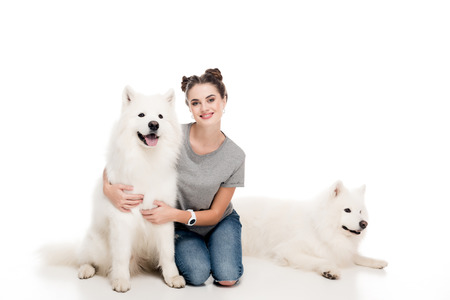 smiling girl sitting with dogs on white Reklamní fotografie